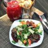 Теплый салат с куриной печенью и вишневым соусом